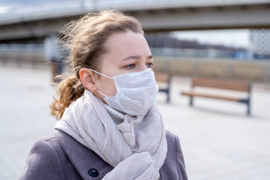 Woman outside with a mask on